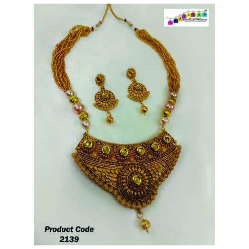 Striking Golden Long Necklace set with Beaded Chain.