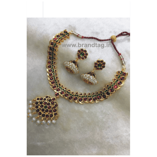 Beautifully Designed Red Stone Golden Necklace set for women !