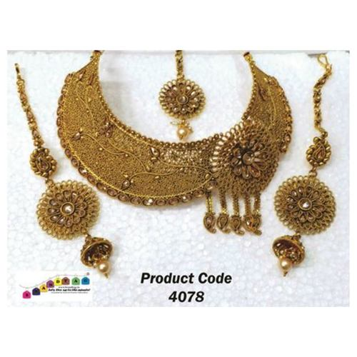 Uniquely Designed Golden Neck fitted Necklace set with Mangtika !