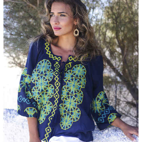 Light navy blue blouse with bright geometric embroidery and tassels front view
