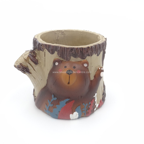 Bear on tree trunk pot