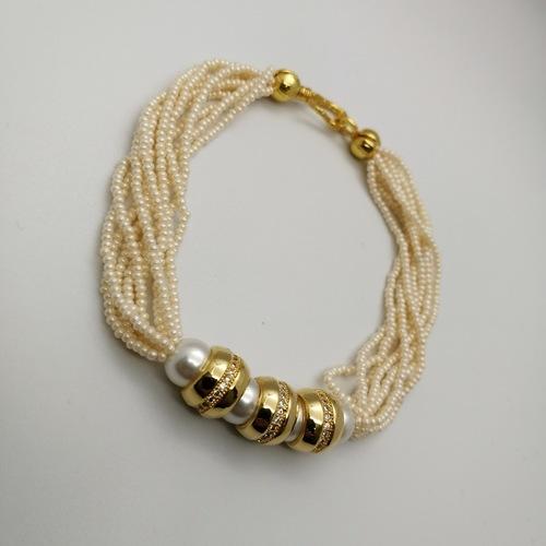 White and Gold Pearls Embellished Bracelet