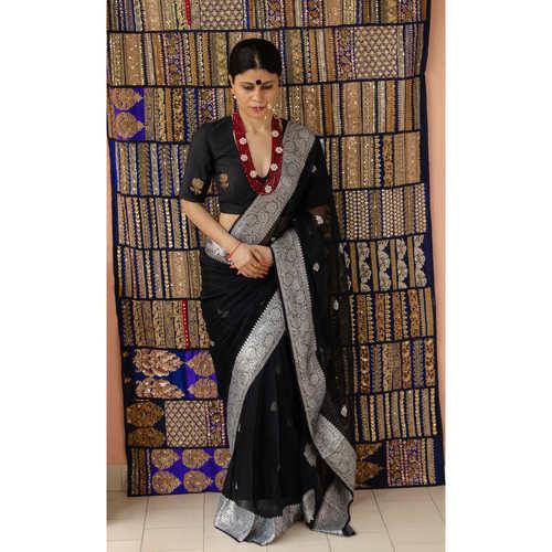 Handwoven kadhwa chiffon Banarasi silk saree with woven motifs.