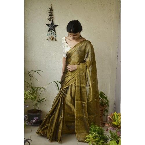 Handwoven Metallic linen Zari saree with jamdani jari bootis.