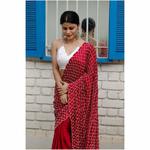 Handembroidered satin silk saree enhanced with  zari scallops and border.
