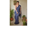 Handwoven linen saree with woven embroidered border