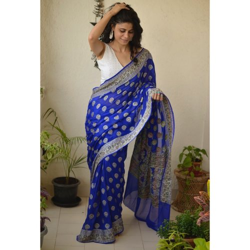 Handwoven Banarasi  georgette saree with  kadhwa motif .