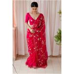 Handloom handembroidered organza silk saree enhanced with  beads  and zari scallops.