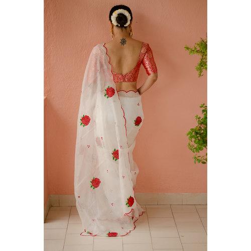 Handloom handembroidered resham silk saree enhanced with  beads scallops.