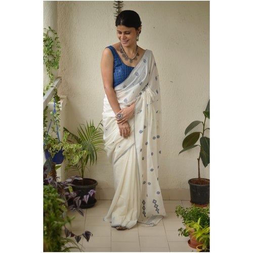 Handwoven muslin line jamdani saree with bootis.