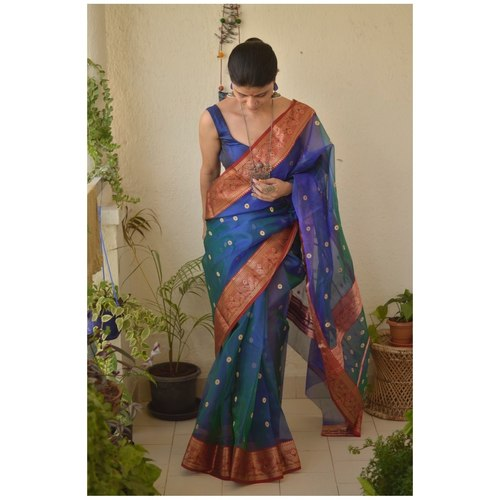 Handwoven Chanderi silk saree with meena bootis motif and handwoven border.