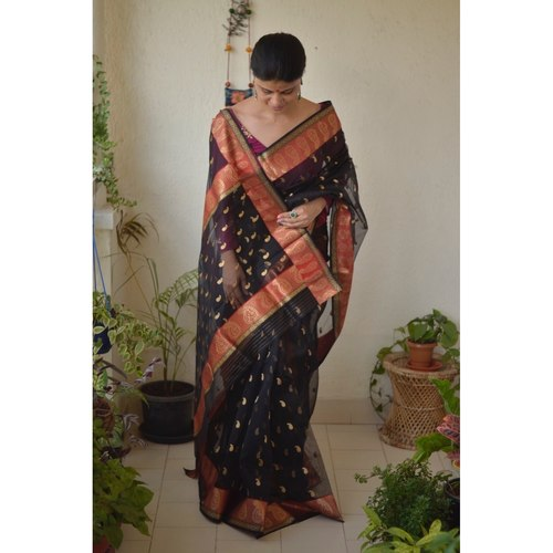 Handwoven Chanderi  silk saree with meena bootis motif and border.