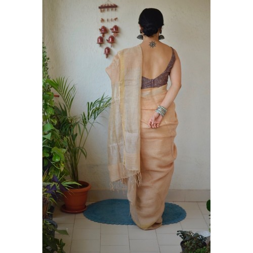 Handwoven linen by linen saree with jari pallu.