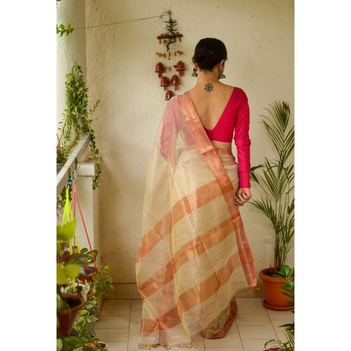 Handloom Maheswari tissue silk saree with woven zari  and resham border.