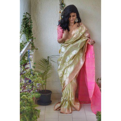 Handwoven katan silk banarasi saree with handwoven  soona roopa motifs.