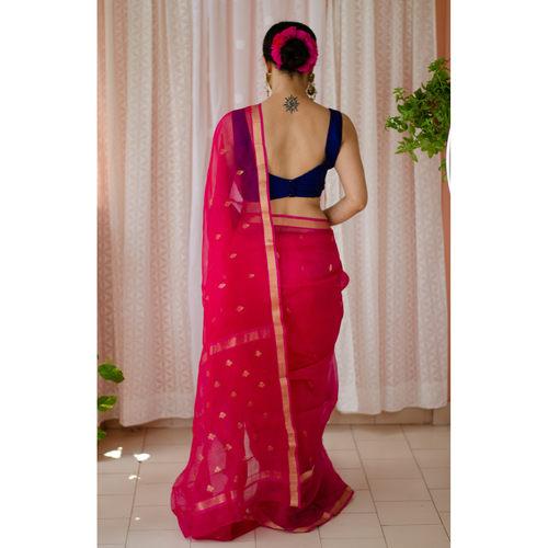 Handloom resham silk with woven jari motifs.