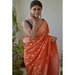 Handwoven katan silk banarasi saree with handwoven motifs.