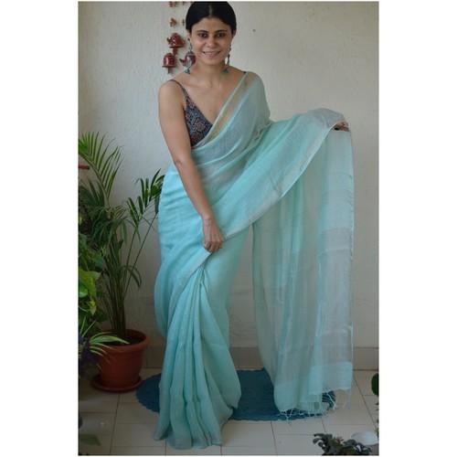 Handwoven linen by linen saree with jari pallu.