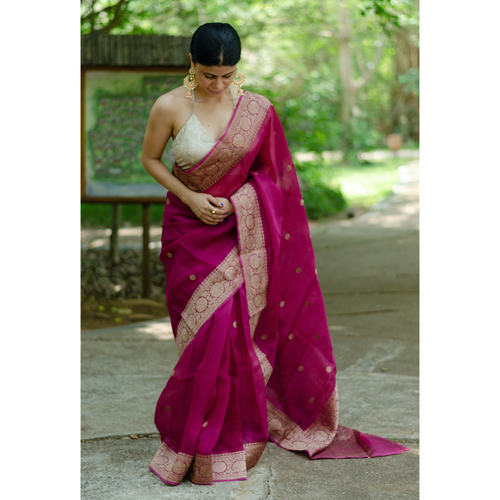 Handwoven organza kora banarasi silk saree with kadhwa border and bootis.