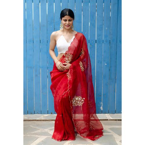 Handloom handembroidered organza resham silk saree enhanced with  zari scallops.