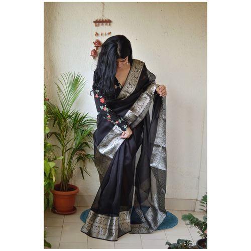 Handwoven organza sheer silk saree with banarasi border.