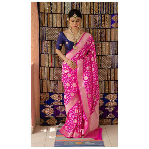 Handloom cutwork katan  Banarasi silk saree with woven motifs.