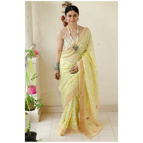 Handblocked printed handloom linen by linen saree with goldsilver zari border.