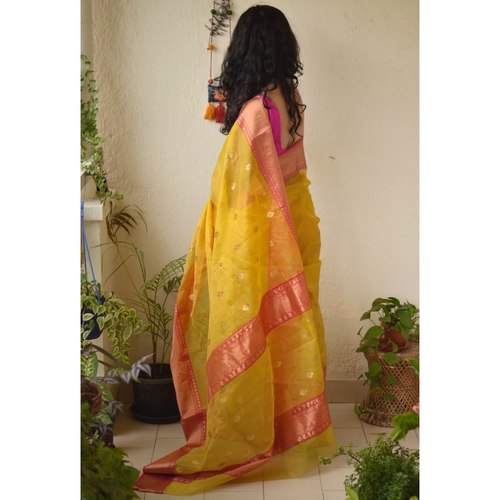 Handwoven Chanderi tissue silk saree with meenakari bootis motif and border.