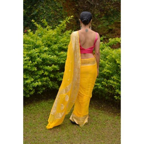 Handwoven chiffon banarasi saree with handwoven silver jari motifs.