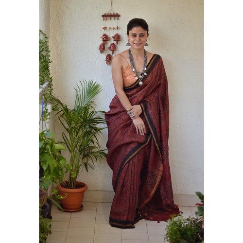 Ajrakh Handblock print handwoven linen saree with jari border.