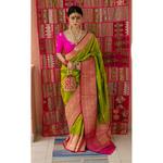 Handloom katan Banarasi silk saree with woven motifs.