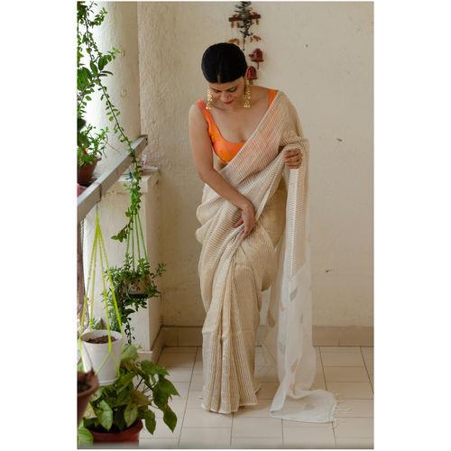 Handwoven twill metallic linen saree with jamdani motifs in pallu.