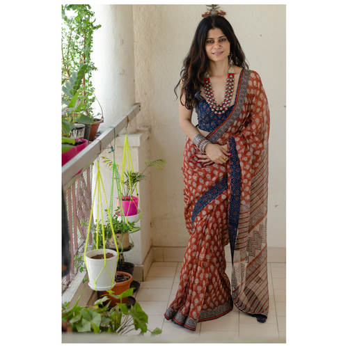 Hand block printed  natural dyed kota doria saree with  natural dyed Ajrakh patch work border and tassel.