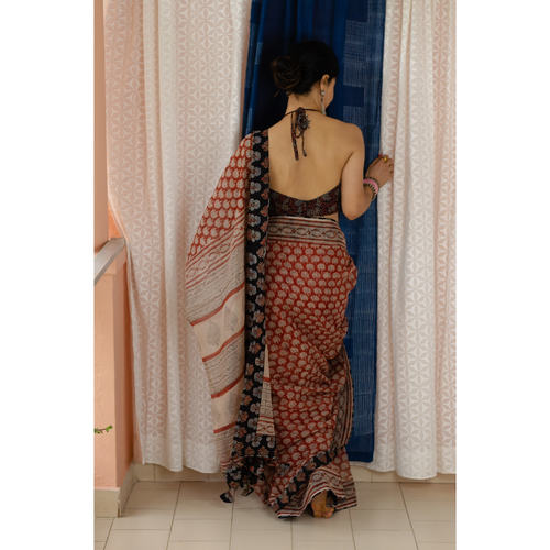 Hand block printed  and natural dyed kota doria saree with  natural dyed Ajrakh patch work border and tassel.