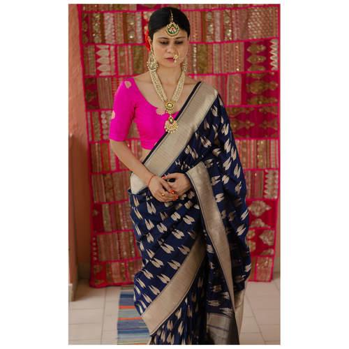 Handllom  cutwork katan   Banarasi silk saree with woven motifs.
