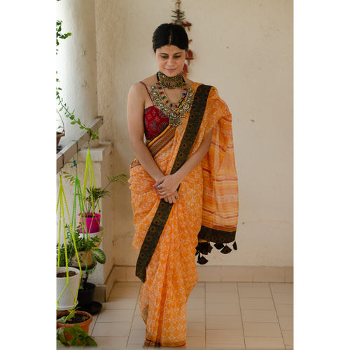 Hand block printed  natural dyed kota doria saree with  natural dyed Ajrakh patch work border and tassel. Description: Hand block pri