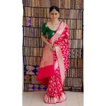 Handloom Katan Banarasi silk saree with  floral woven motifs.