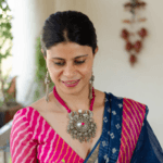 Handmade pure pendant with pink thread