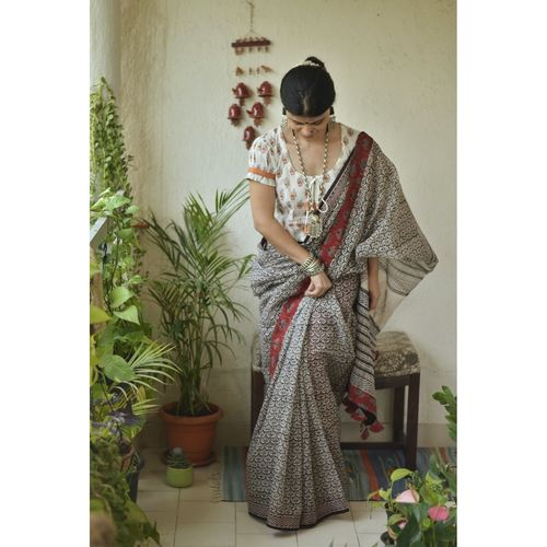 Hand  block printed  natural dyed kota doria saree with Ajrakh patch work border and tassel.