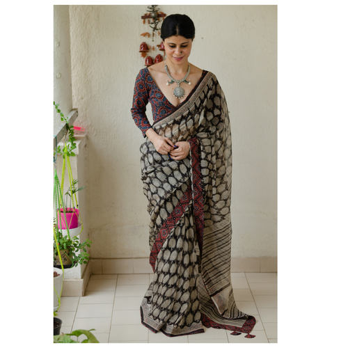 Hand block printed  and natural dyed kota doria saree with  natural dyed Ajrakh patch work border and tassel