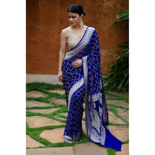 Handloom chiffon khaddi banarasi saree with silver jari booti.