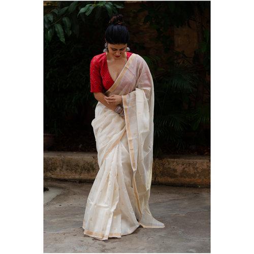Handloom chaderi cotton silk saree with handwoven  gold jari motifs in all over the saree and jari stripes in pallu.
