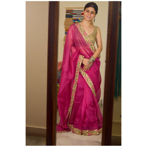 Organza  Silk Saree ,elevated with jari  thread and sequins hand embroidered border.
