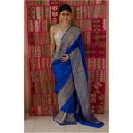 Handwoven kadhwa moonga silk  banarasi saree with silver gold jari motifs.