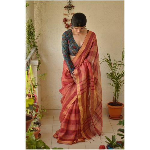 handloom linen by linen saree with goldsilver zari border.