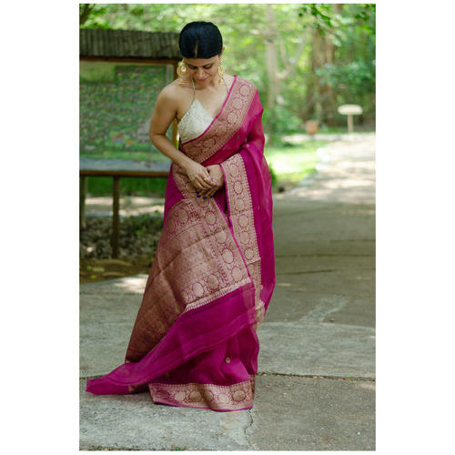 Handwoven organza kora banarasi silk saree with kadhwa border and bootis.