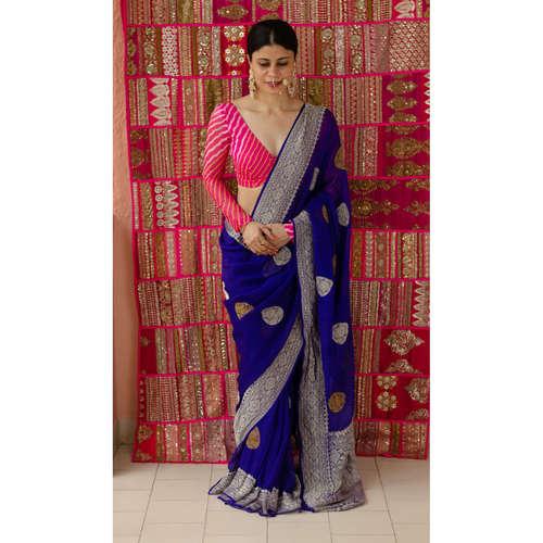 Handloom kadhwa chiffon banarasi saree with silver and gold jari motifs.