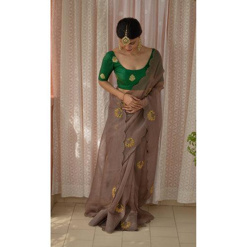Handloom handembroidered organza resham silk saree enhanced with  resham thread  scallops.