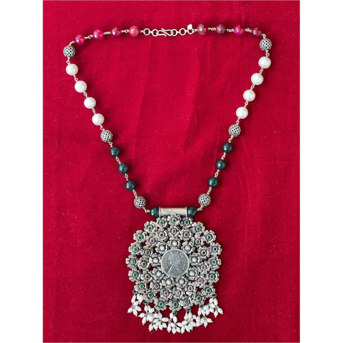 Handmade silver neckpiece with  semi emerland and perl stone and antique pendant.