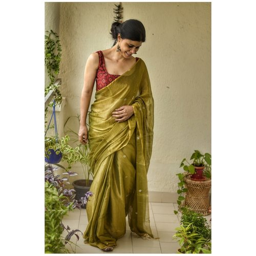 Handwoven Metallic linen Zari saree with jamdani jari bootis.